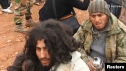 """Бойцы """"Исламского государства"""", сдавшиеся в плен """"Аль-Каиде"""" в Сирии (архивное фото)"""