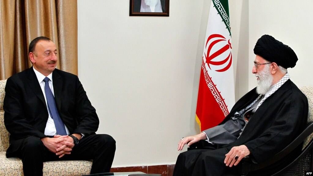 Iran's Supreme Leader Ayatollah Ali Khamenei (right) met with Azerbaijani President Ilham Aliyev in Tehran on March 5. (file photo)