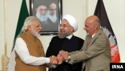 Iranian President Hassan Rouhani (C) with Indian Prime Minister Narendra Modi (L) and Afghan President Ashraf Ghani after signing a three-way transit agreement on Iran's southern port of Chabahar in May 2016.