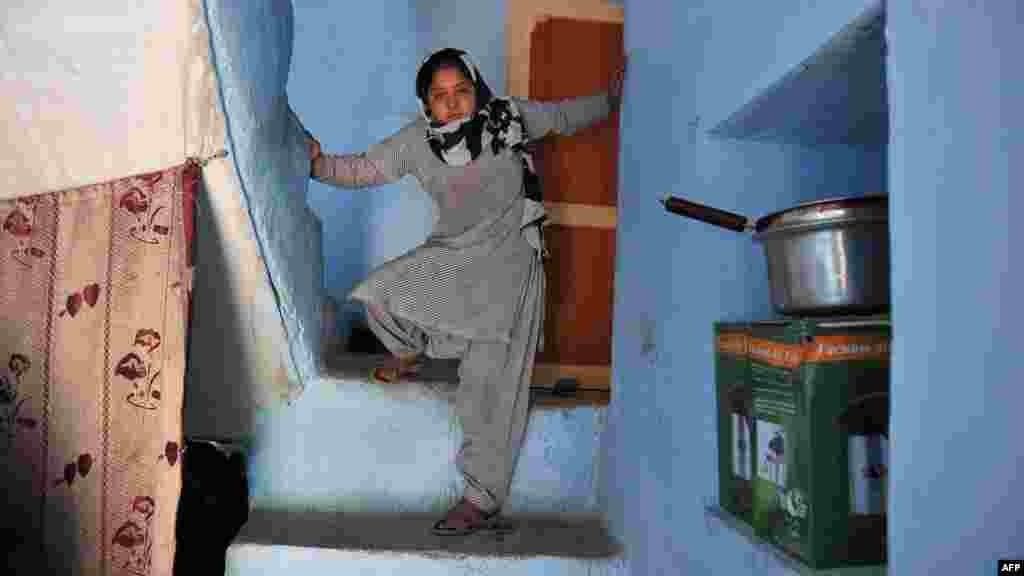 "Eleven-year-old Akbari, the ""girl in green dress,"" at her home in Kabul on April 17. (AFP/Shah Marai)"