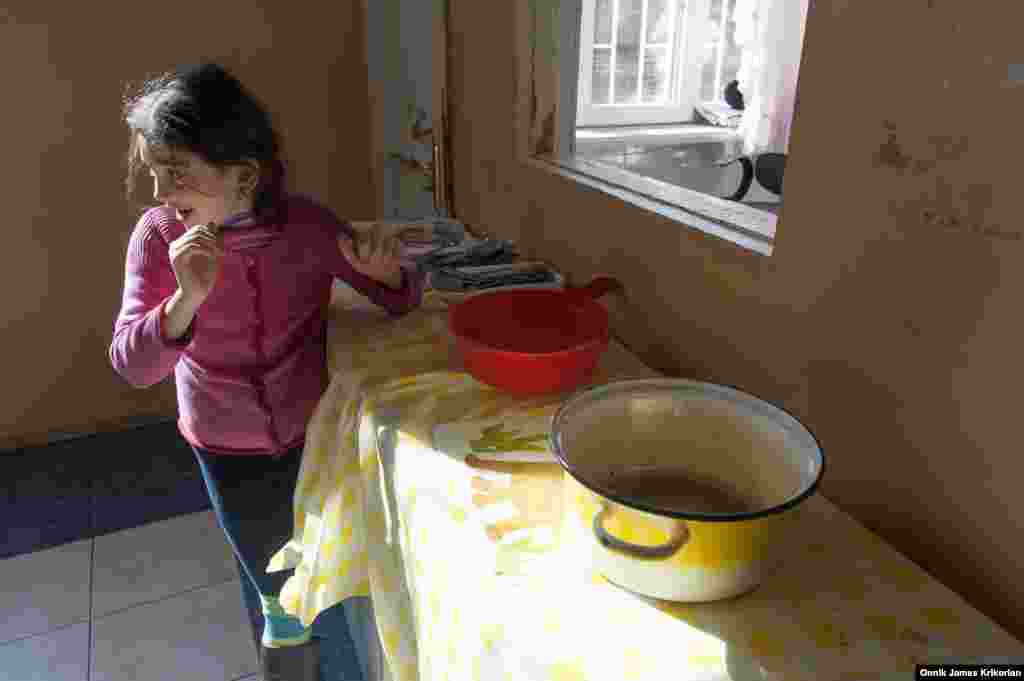 "With institutions considered a ""primary social safety net"" for children from socially vulnerable families, another key element in Georgia's reform program has been the establishment of centers where children from socially vulnerable families can receive food and other assistance, such as this one operated by the group ""Child and Environment."""