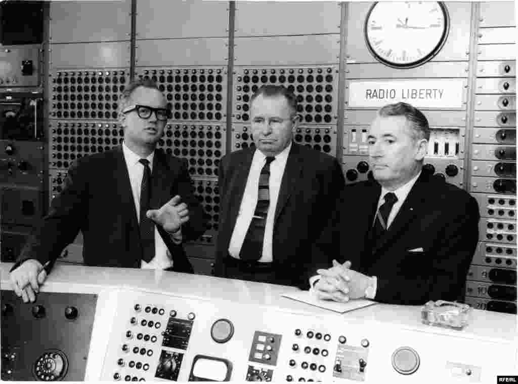 The head of Radio Liberty's Engineering Department, Richard Jewel Tanksley (left), shows some guests the master control room in Munich in 1964.