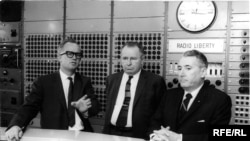 Germany -- Radio Liberty Master Control; Head of Radio Liberty's Engineering Department Richard Jewel Tanksley (L) , Munich, 1964.