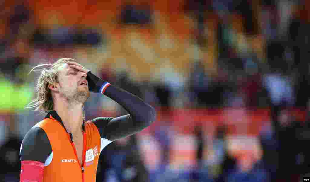Michael Mulder of the Netherlands reacts after winning gold in the mens 500-meters speed-skating event in Adler Arena.
