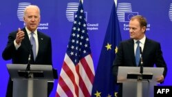 European Union President Donald Tusk (right) listens to U.S. Vice President Joe Biden at EU headquarters in Brussels on February 6.