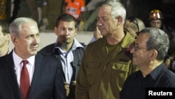 "Even as Israel's Prime Minister Benjamin Netanyahu (left) continues to talk of a ""red line"" Iran's nuclear program must not cross, Defense Minister Ehud Barak (right) has suggested that that line may have moved."