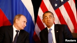 Russian President Vladimir Putin (left) and U.S. President Barack Obama hold talks in Mexico in June 2012.
