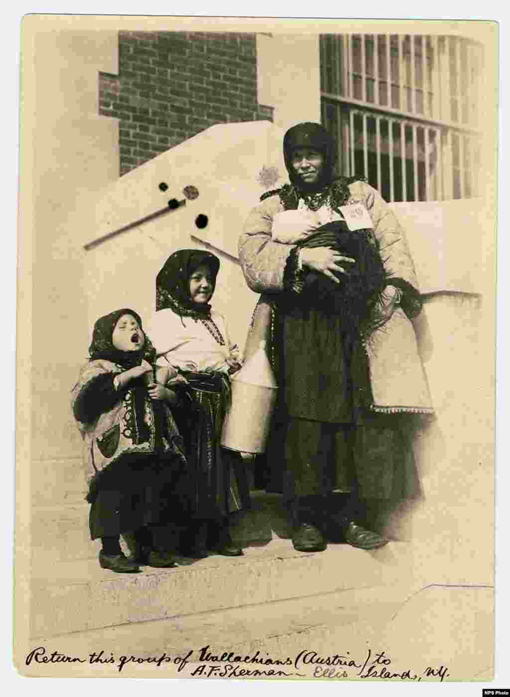 Wallachian woman with her three young children. Wallachia or Walachia, is a historical and geographical region of Romania north of the Danube and south of the Southern Carpathians. The handwritten note says Austria -- some of these areas were part of the Austro-Hungarian Empire prior to World War I.