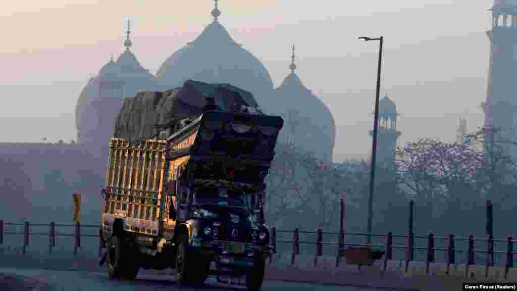 A truck turns on an overpass beside the Badshahi Mosque in Lahore, Pakistan. (Reuters/Caren Firouz)