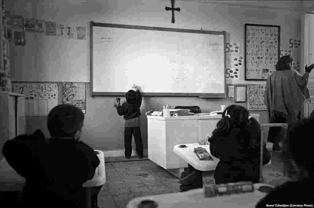 "A young student practices the Armenian alphabet at the Boghossian School in Alexandria, Egypt. ""I don't think Armenians have ever fully adjusted to living in the diaspora,"" one subject told Tufankjian. ""In many ways -- financial stability, home, careers -- they have. But there's always a longing for something more...something that always pulls them to not fully be engulfed in the cities and countries they are living in now. They are always searching for something that is lost."""