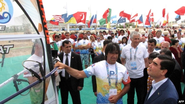 Turkmen President Gurbanguly Berdymukhammedov (right) meets participants of a leg of the windsurfing World Cup at the Turkmen Caspian Sea resort of Awaza on July 1.