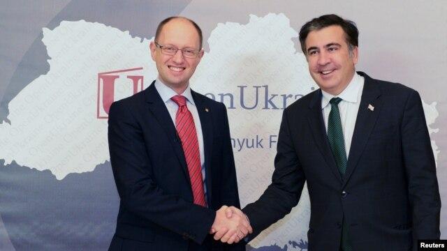Happier times: Arseniy Yatsenyuk (left), then in opposition, meets with then-Georgian President Mikheil Saakashvili in Kyiv in November 2012.