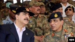 General Ashfaq Pervez Kayani (right) talks with Prime Minister Yousaf Raza Gilani during the third phase of Pakistan's biggest-ever army field exercise in April.