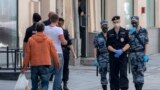 Russian National Guard soldiers and police officers patrol in downtown Moscow.