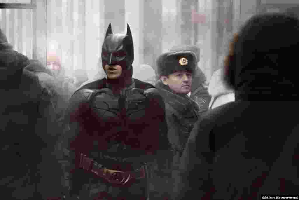 Batman in a Russian crowd.
