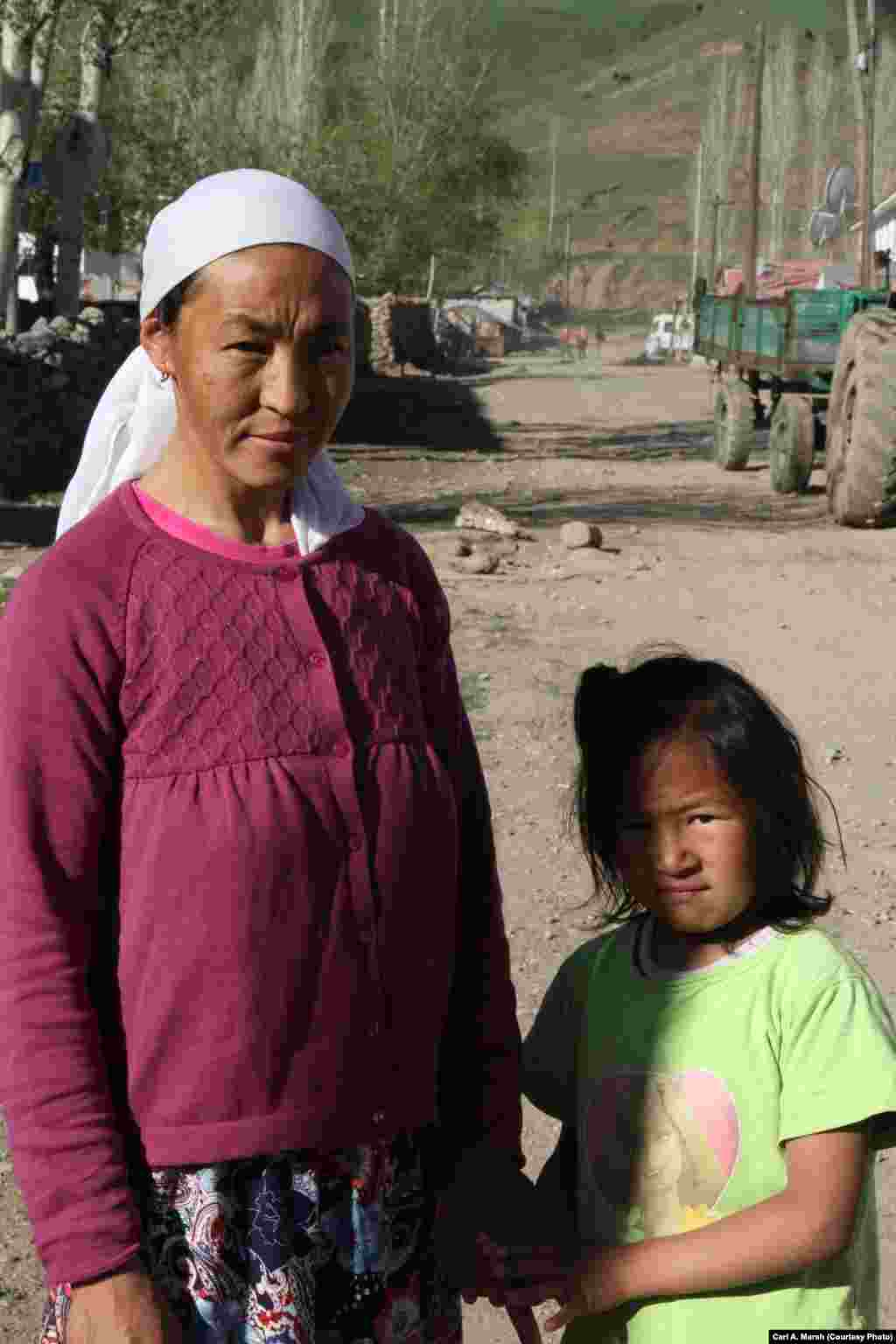 Asil and her daughter, Semanur, one of four siblings. The children have learned the Kyrgyz language as well as Turkish. The family plans to move to Istanbul to seek better educational opportunities for the children.