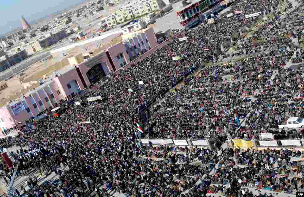 Demonstrators gather for an antigovernment protest in the central Iraqi city of Samarra. Thousands of Sunni Muslims took to the streets of Baghdad and other parts of Iraq to decry the alleged targeting of their minority, in rallies hardening opposition to the country's Shi'ite leader. (AFP)
