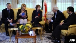 Iranian Deputy Foreign Minister Abbas Araghchi (right) attends a meeting with Foreign Minister Mohammed Javad Zarif (2nd-right) with EU foreign-policy chief Catherine Ashton (center) during talks over Iran's nuclear program in Geneva in November.