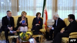 Iranian Foreign Minister Mohammed Javad Zarif (second right) and his deputy Seyyed Abbas Araghchi (right) in discussions with EU foreign policy chief Catherine Ashton (center) over Iran's nuclear program in Geneva on November 20.
