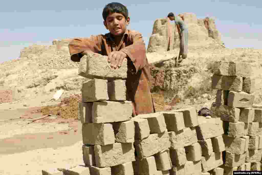 A boy working in construction. Photo by RFE/RL's Radio Free Afghanistan