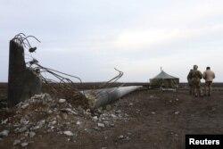 Одна из уничтоженных электроопор в Херсонской области Украины. 22 ноября