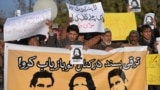 FILE: Pakistani human rights activists protest the disappearances.