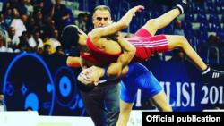 Борец Акбар Кенжебек уулу на одном из международных турниров.