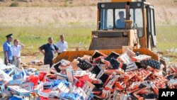 A worker uses a bulldozer to crush crates of banned peaches outside the city of Novozybkov, about 600 kilometers from Moscow, on August 7.