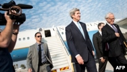 U.S. Secretary of State John Kerry (center) arrives at Tel Aviv's Ben Gurion Airport on January 2.