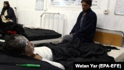 An injured boy receives treatment at a hospital after an air strike in Afghanistan's Garmsir district on November 27.