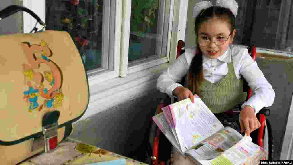 Nelea Lungu, 11, lives with her grandmother in the Moldovan village of Roscani. Her mother works in Moscow. Nelea wants to be able to go to school in her village, but the school has refused to admit her because of her disability.