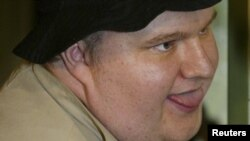 Internet millionaire Kim Dotcom pictured during his trial for insider trading and embezzlement in 2002