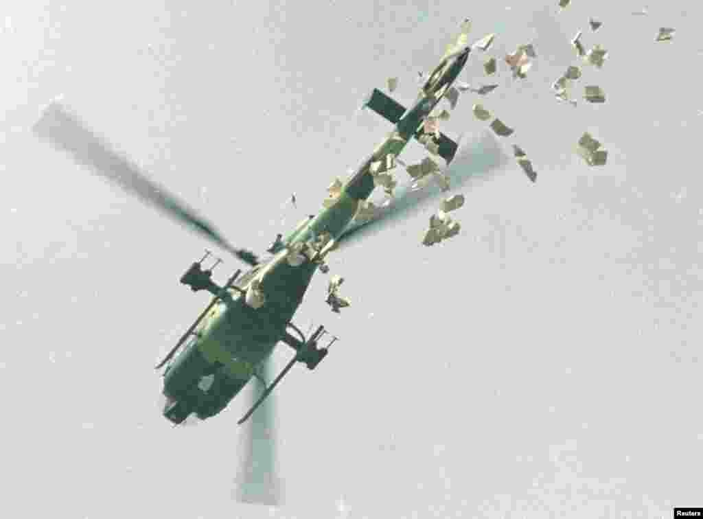 A military helicopter drops leaflets ordering protesters to leave Tiananmen Square immediately on May 22.