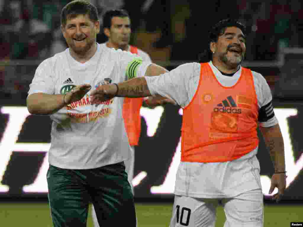 Chechen leader Ramzan Kadyrov (left) shares a joke with soccer legend Diego Maradona during an exhibition soccer match at the opening of the Akhmed-Hadzhi Kadyrov Stadium in Grozny on May 11, 2011.