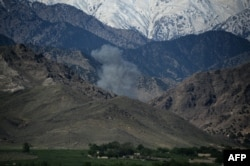 Smoke rises after an air strike on Islamic State (IS) militants in an operation in the Achin district of Nangarhar Province on April 14, one day after the dropping of the MOAB bomb in the same area.