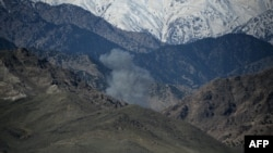 Smoke rises after an air strike on Islamic State (IS) militants positions during an ongoing operation against the group in the Achin district of Nangarhar province on April 14.