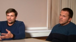 Anatoly Chepiga, aka Ruslan Boshirov (left), and Aleksandr Mishkin, aka Aleksandr Petrov, speak to RT in Moscow on September 13.