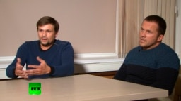 Men identifying themselves as Ruslan Boshirov (left) and Aleksandr Petrov -- now believed to be GRU officers Anatoly Chepiga (left) and Aleksandr Mishkin -- speak to the Kremlin-funded RT channel in Moscow on September 13.