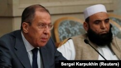 Russian Foreign Minister Sergei Lavrov (left) and Taliban delegate Alhaj Mohammad Sohail Shaina take part in multilateral peace talks on Afghanistan in Moscow in November 2018.