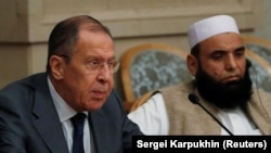Russian Foreign Minister Sergei Lavrov and member of Taliban delegation Alhaj Mohammad Sohail Shaina take part in the multilateral peace talks on Afghanistan in Moscow, November 9