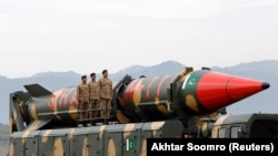 FILE: Pakistani soldiers stand beside a Shaheen III surface-to-surface ballistic missile during a military parade in Islamabad in March 2019.