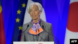 IMF Managing Director Christine Lagarde addresses the Paris Forum at the Economy Ministry in Paris on May 7.