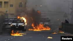Столкновения во время акции протеста в селении Ситра 15 марта 2012