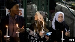 Mourners hold candles for victims of the mass shooting in San Bernardino, California.