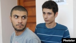 Opposition activists Davit Kiramijian (left) and Sargis Gevorgian at the start of their trial in Yerevan on July 14