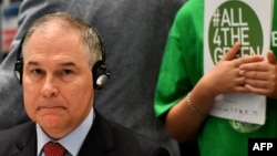 The head of the U.S. Environmental Protection Agency, Scott Pruitt, looks on during a meeting at the G7 environment summit in Bologna, Italy, on June 11.