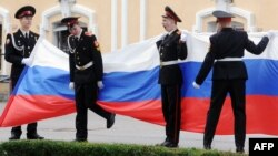 Russian cadets displaying their country's flag.(illustrative photo)