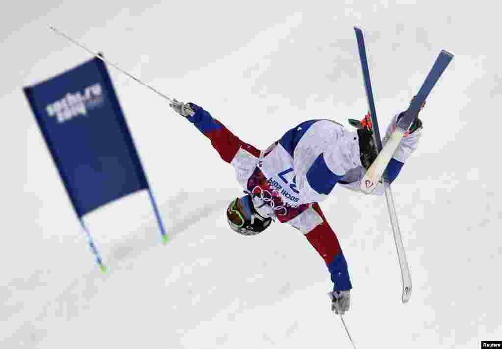 Russia's Andrei Volkov performs a jump during the men's freestyle-skiing moguls qualification round.