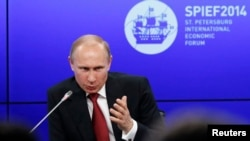 Russian President Vladimir Putin speaks at the St. Petersburg International Economic Forum on May 23.