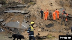 Armenia - Rescue teams work at the site of a powerful landslide, 3Oct2011.